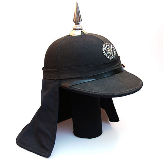 A black cloth covered cork helmet, as used by the Jordanian Army in the 1950s and 1960s. (Author's collection)