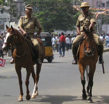 The Chennai City Mounted Police Officer wears a Bombay Bowler style sun helmet