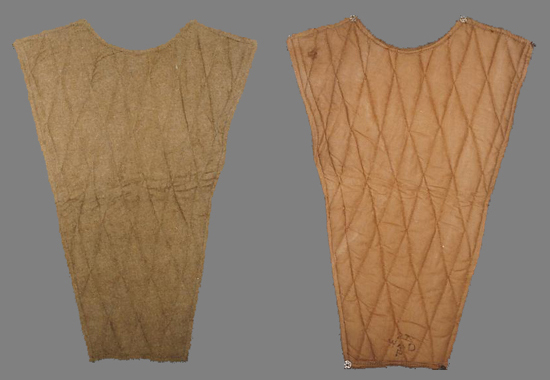 A First World War variation of the spine pad showing the snap fasteners (press studs) which allowed attachment of the spine pad to the soldier's shirt or coat. An alternative to snap fasteners was the use of hooks and eyes with the hooks attached to the spine pad and the eyes to the rear of the shirt or coat. (Photo courtesy of James Holt)