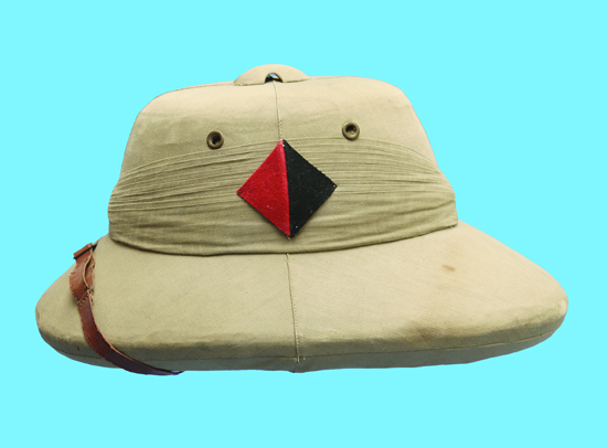 This Khaki Solar Pith Hat is dated 1937 and attributed to Lt. G. C. Moor R.A. It was manufactured by the Peninsular Hat Company of Calcutta. (Author's collection)