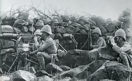 A Maxim gun crew during the 2nd Boer War. Note the officer's helmet far right.
