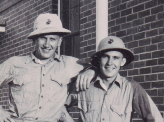 Two soldiers wearing the pressed fiber helmet while off duty. Note the typical USMC EGA (Eagle, Globe, Anchor)
