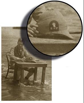 Shades of Monty Python in the Transvaal… A Royal Welsh Fusilier officer cooling off while sitting at a desk in a river. (Author's collection)