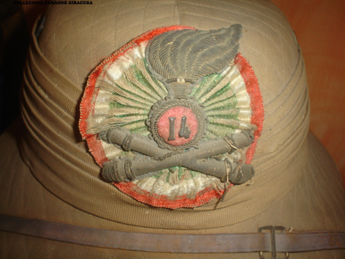 "The artillery (Ordnance) badge on the Italian ""Aden"" Helmet (Collection of Enzo Faraone)"