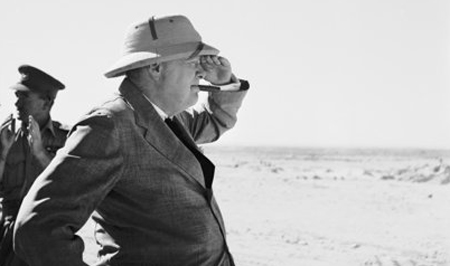 Mr. Churchill no doubt looking as much to the past as to the future in his trip to Egypt during World War II. He is wearing a Bombay Bowler pattern helmet.