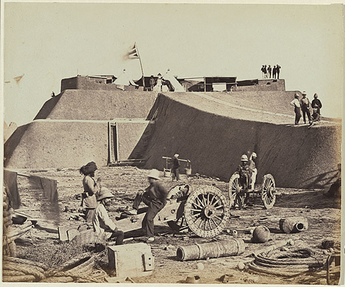 "This famous photo, by Felice Beato, titled ""Headquarter Staff Pehtang Fort 1st August, 1860"" shows the styling difficulties encountered early with the use of wicker. The helmet in the left foreground shows the distinct slab-sided nature of these early examples."