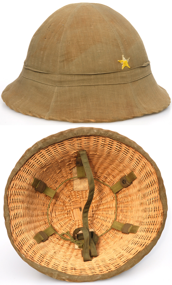 A variation of the Type 90 style sun helmet, it is made of wicker and features no internal lining. The liner band is attached directly to the wicker. It is believed this was likely a late war-time economy measure – but the level of detail in the wicker pattern is impressive.