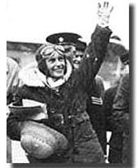 The same helmet is carried here by Batten on her arrival on Croydon aerodrome, 1935.