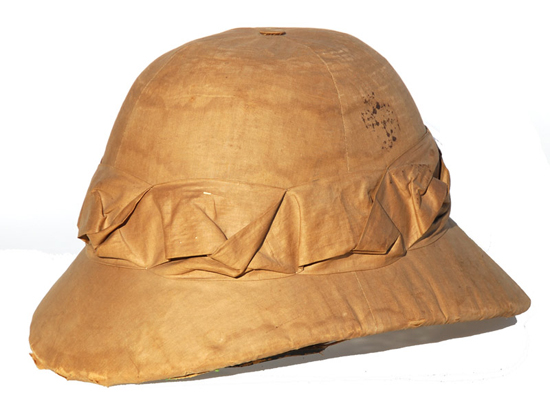 "A Hong Kong made ""sola pith"" helmet. Note how the helmet appears somewhat ""thick?"" This is because sola pith is a soft material that is reinforced with wicker and even paper."