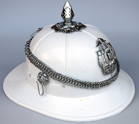 A close up view of the Thai Royal Guard helmet with silver fittings.
