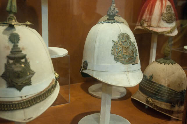 Various sun helmets in the Royal Thai Army Museum show the British influence