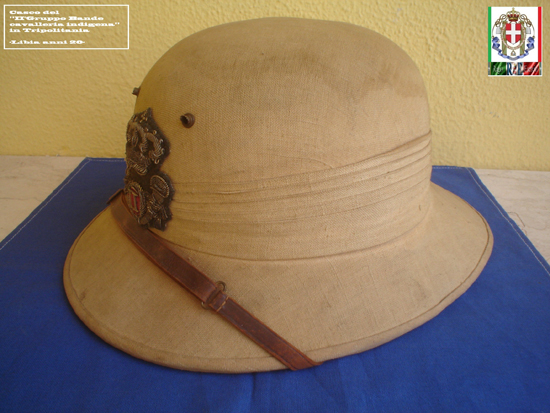 "An Italian straw helmet produced by Radiconcini in Rome likely in the 1920s. This example features the ""Light Cavalry"" badge for the 2nd Irregular Native Troops in Libya. It is made in three layers : cotton gauze, aluminum insulation and straw."