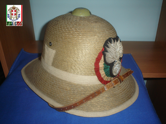 A Model 1928 helmet, made of straw, with the insignia of the Royal Carabineers. This pattern helmet was typically also used by the military police corps (Carabinieris Reali), and is often associated with the PAI (Polizia Africa Italiana).