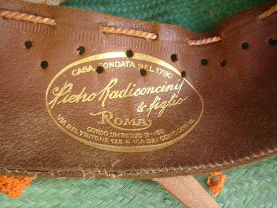 A close up of the stamp on the leather headband. This close-up also gives a good view of the straw material used to produce the helmet.