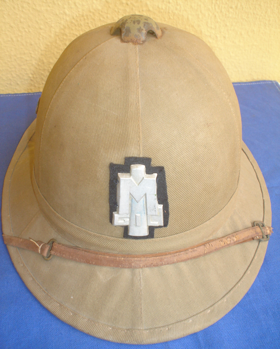 "The front view of the helmet shows that the fabric-covered ""Massawa"" canvas is identical to the adult model."