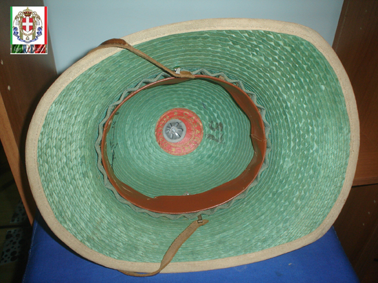 The interior of the helmet shows the straw wicker construction along with the headband.