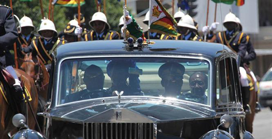 President Robert Mugabe being escorted by the Presidential Guard