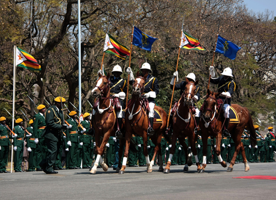 Zimbabwe Presidential guard puts on a procession and a guard of honor at the official opening of parliament in Harare 26 August 2008.
