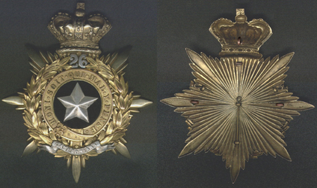 A superb example of a helmet plate showing the method of attaching the centre device and the three lugs which secure the plate to the helmet. It is interesting to note that the bottom lug, through which the cotter pin passes, secures the regimental scroll which is separate from the garter and wreath. (Photo courtesy of Benny Bough)