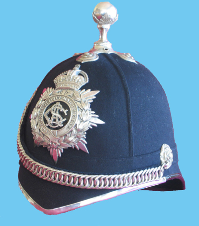 "An example of the ""ball in leaf cup"" top-piece and a volunteer unit's (silver or white metal furniture) officer's Home Service Helmet to the Army Service Corps. (Author's collection)"