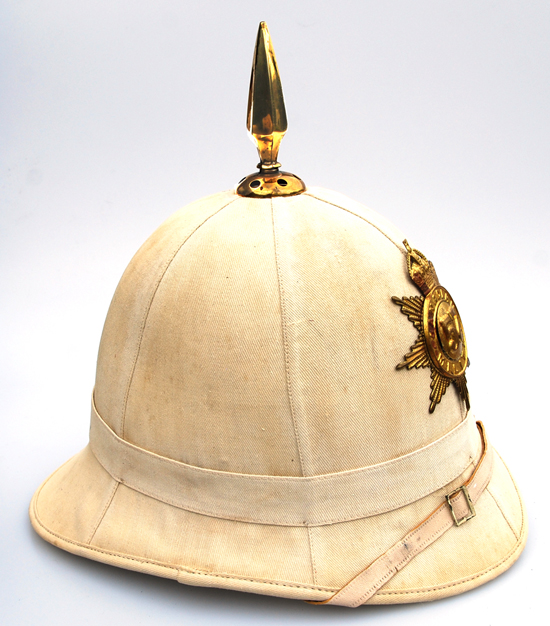 A 1905 era Canadian Militia sun helmet with the badge of the 57th Regiment, Peterborough Rangers.