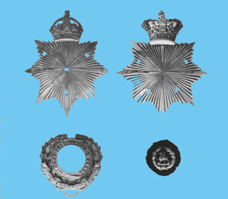 An example of the design and construction of an officer's helmet plate of the three pieces type. Note the holes through which the lugs attached to the garter and wreath and the centre device were passed and secured to the backing plate by cotter/split pins.