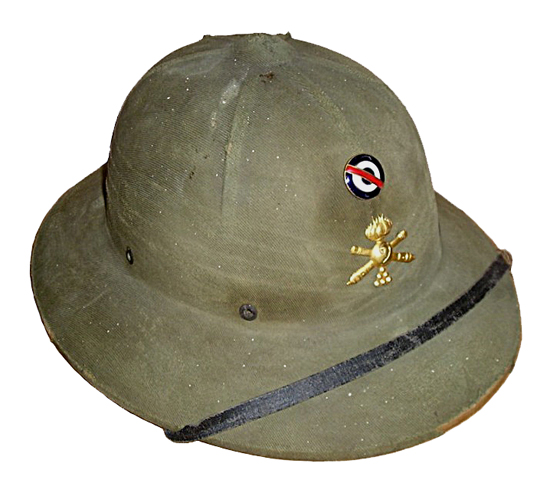 An American-made Hawley pressed fiber helmet, likely produced after World War II, which features an enlistedman's artillery badge and Uruguayan cockade. These helmets were used in large numbers in the 1950s and 1960s until being removed from general service.
