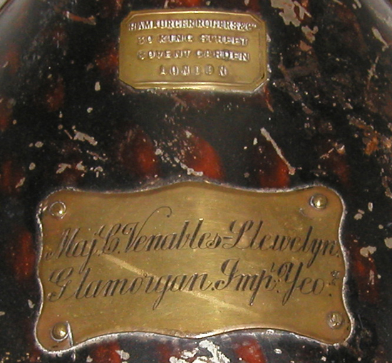"The owner's plate on the helmet tin, which notes ""Major C. Venables-Llewelyn"""