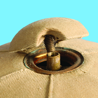 A cloth covered zinc button which screwed into the ventilation collet. (Author's collection)