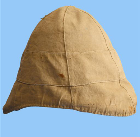 A khaki cover over a white helmet. Note that the drawstring used to tighten and secure the cover to the helmet is missing. (Author's collection)