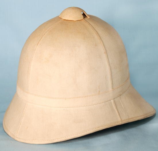 "The ""Classic"" American Sun Helmet of the late 19th Century. This Model 1887 helmet features four panel construction and is constructed of cork covered with bleached cotton drill."