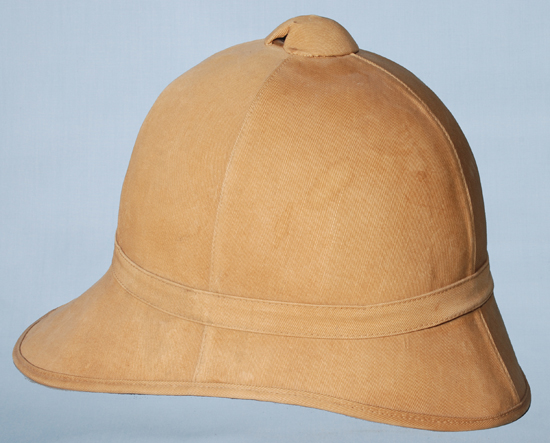 An American Model 1889 sun helmet with tan drill cloth covering. This style of helmet was used in the Spanish-American War, during the Philippine Insurrection and with American military units serving in China.