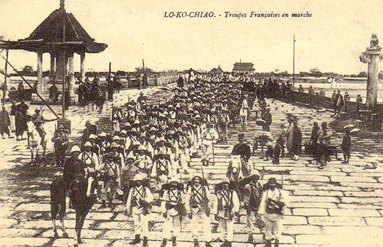 French soldiers at the Lo-Ko-Chiao bridge in China during the Boxer Rebellion. Note that most of the French soldiers are wearing colonial pattern helmets.