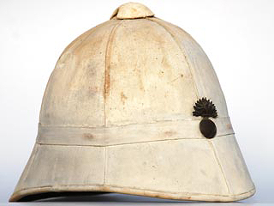 "An M1886 helmet that features the flaming bomb of the ""Gendarmerie."""