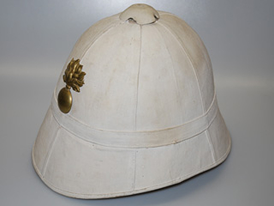 Another M1886 pattern helmet with a flaming bomb insignia that was used by the French Foreign Legion prior to World War I.