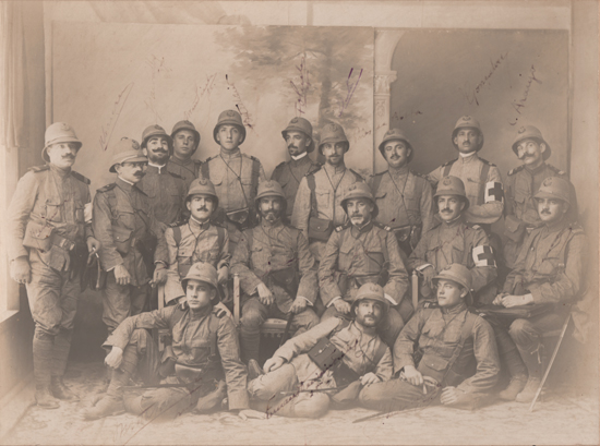 "Fig. 10: Officers of the Naval Fusiliers Battalion in Angola, c. 1914. Notice the ""field tops"" worn. Officers of this unit wore blackened metal anchors over a laurel. Other ranks wore only the anchor."