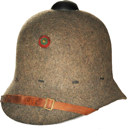 "Fig 5: A 1913 helmet for other ranks. Note the ""field-top"" and the soldiers' number written on the chin-strap. The hatband is missing, showing the metal attachments that secure the sweat-band."