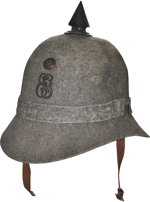 "Fig 6: A 1913 helmet for a cadet. The letters ""EG"" on the badge stand for ""Escola de Guerra"" (War School). This is a fine example of a ""Metropolitan"" 1913 helmet."