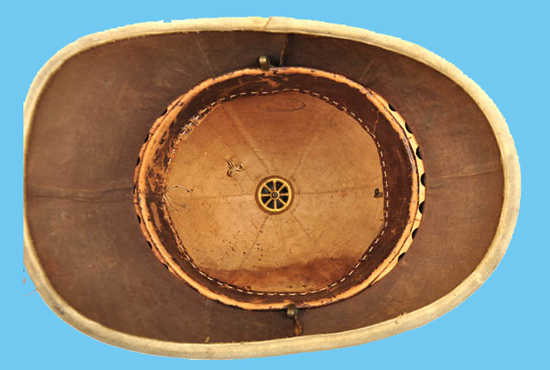The interior of the West Surrey helmet showing the corrugated cork ventilation between the headband and the helmet shell. The maker's stamp is also visible. This method of ventilation does not appear in India where it was considered to be inadequate. (Photo courtesy Roland Gruschka)