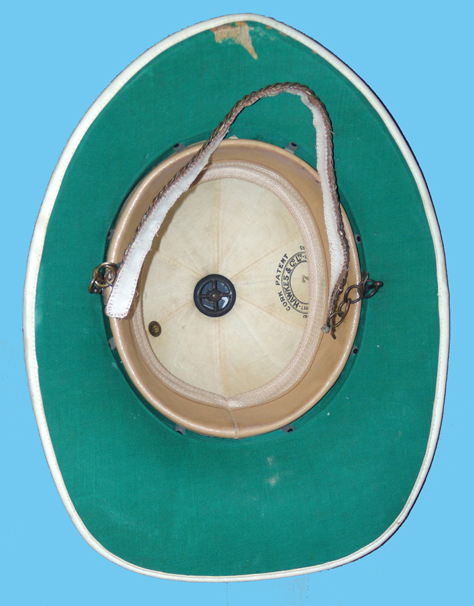 The interior of the Wolseley showing the cotton mesh attachment to the leather headband, the high hook nut and bolt and the maker's stamp of Hawkes & Co. The method of ventilation between the helmet shell and the headband is clearly that of Hawkes patent of 1917. (Photo courtesy of Christopher Mills)