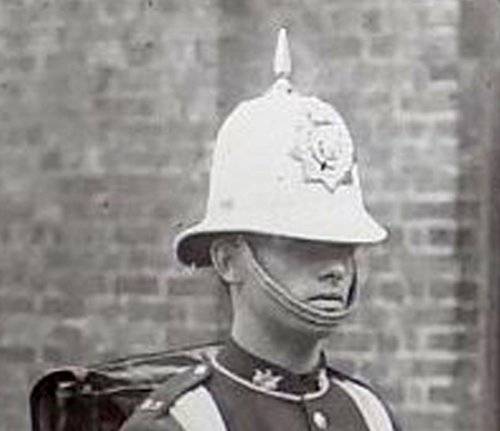 The same helmet worn by the Royal Scots, as can be seen from the collar badges and helmet plate.