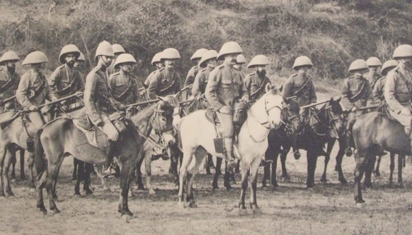 A mounted Infantry section of the Norfolk Regiment stationed at Mandalay, Burma, in the 1890s, riding their little Burmese ponies, trying out greater mushroom sola topees. (The Jaunty Hat)