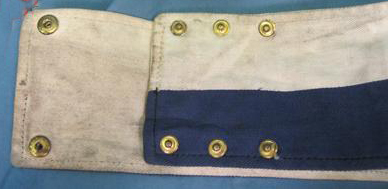 An example of a WWII armband illustrating the method of adjusting to fit different arm sizes. (Courtesy Stewart's Militaria)