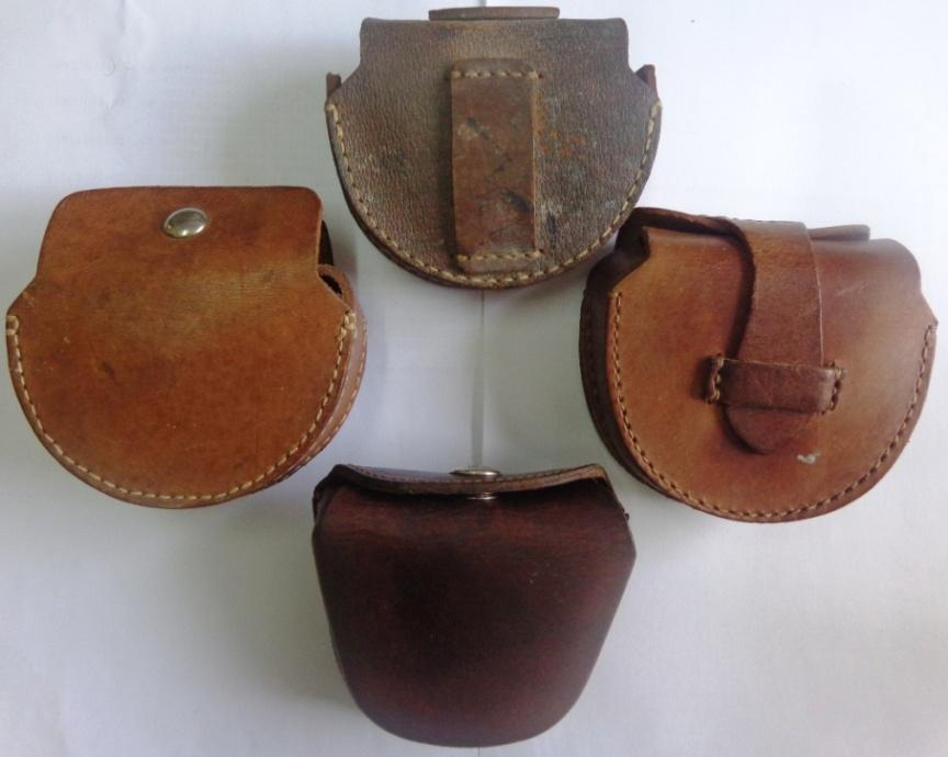 Figure 14. Leather cases, the top three are Japanese military for the Type 5. The (left) has a snap fastener, (right) has a tongue and loop closure. At top a rear view showing belt loop, this often has the owners name written on it. At bottom is a 1960s Chinese folding goggles case for comparison.