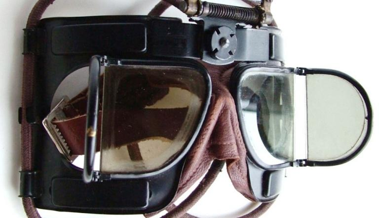 Figure 26. The first new design of goggle for the RAF in WWII, the Mk IV. That its ancestry was the earlier folding split lens goggle types is perhaps best shown by the hinged 'window' frames of the first Mk IV model. As they were supposed to be worn continually by pilots the concertina fold-ability of the earlier soft mask versions was deliberately missing. The 'lenses' were officially called 'windows' by the RAF; as the term lens intrinsically implies a distortion of light in some way. (image www.historicflyingclothing.com)