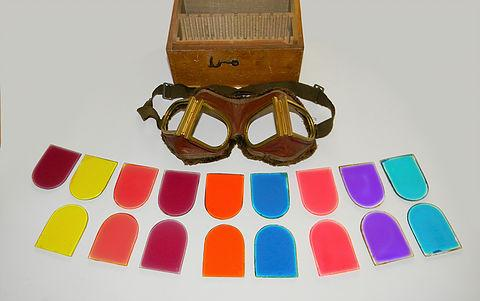 Figure 9. WWI British, Royal Naval Air Service, specialist goggles with numerous different coloured lenses used for signal flare enhancement. These had strong brass frames to withstand repeated lens changes, and had a thick fur trim to the back of the leather mask.